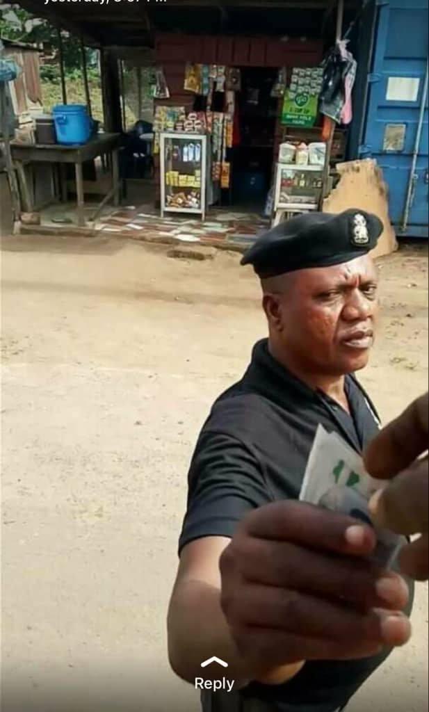Caption the look on this police man's face