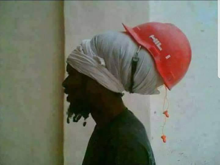 Rastaman and the helmet